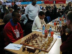 FM Ryan Harper and NM Yogi Ramsingh (TRI) vs. Moldova (MDA). Copyright © Barbados Chess Federation, 2002.