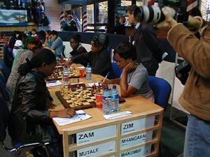 Zambia vs. Zimbabwe (Women). Copyright © Barbados Chess Federation, 2002.