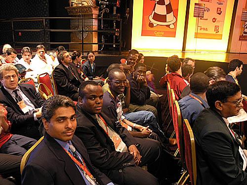 Jamaica's Shane Matthews and Duane Rowe sitting next to the Ugandans.