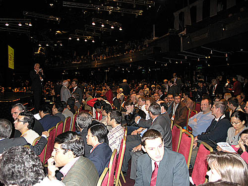 The Olympiad crowd in anticipation of ceremonies. Viswanathan Anand is caught in the lower left.