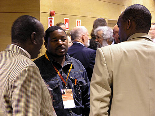 Malawi's Kezzie Msukwa (center) with Uganda's Enoch Barumba and Rwanda's Rugema Ngarambe during the General Assembly at the 2004 Chess Olympiad in Calvia, Spain.