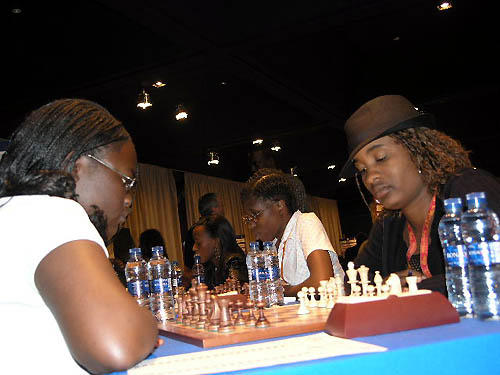 Kenya vs. Botswana - Tshepiso Lopang (near right) faces Linda Abur Amolo on board #3 while Tuduetso Sabure (center) and Boikhutso Mudongo (far end) ponder their next moves.