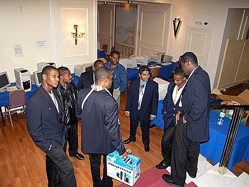 Caribbean players conversing  (L-R) Mark-Jon Alleyne (Barbados), Delisle Warner (Barbados), Kevin Denny (Barbados), Duane Rowe (Jamaica), Russel Porter (Jamaica), Shane Matthews (Jamaican), Terry Farley (Barbados), Peter Dawson (Barbados).