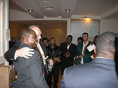 Wilkinson presents book to Chief Arbiter at the Bled Olympiad, Geurt Gjissen. South African Chess President Lyndon Bouah is in the green jacket. He received a donated copy from Jerry Bibuld. For permission to use the photographs in the book, Bibuld asked that Wilkinson present copies to three federations: South Africa, Kenya and Mozambique.