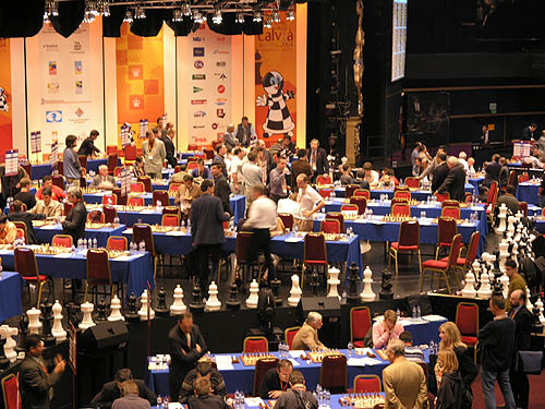 Tense moments at the 2004 Chess Olympiad as games were going late into the day. I was with a few of the Barbados players and we were watching to see if Kevin Denny would hold hold a draw. He did!