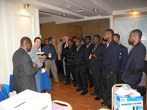 Barbados delegate Allan Herbert praises Ian's Wilkinson's magnanimous effort while players from Jamaica and Barbados look on. Presidents of Uganda and South Africa received complimentary copies in care of Jerry Bibuld. The Chief Arbiter of the Bled Olympiad Geurt Gijssen and FIDE official Boris Kutin were also present at the unveiling and received complimentary copies.