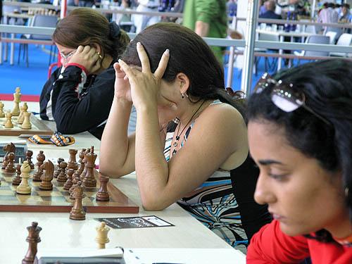 Cuban women in deep thought. Copyright © 2006, Daaim Shabazz.