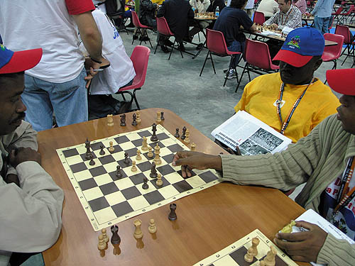 Haitians analyzing game during the 2006 Olympiad in Turin, Italy.