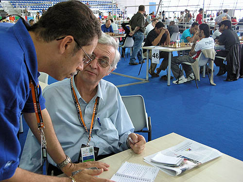 Allen Herbert of Barbados conferring with Wheeler at the 2006 Chess Olympiad in Turin, Italy. Photo by Daaim Shabazz.