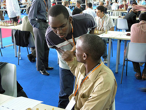 Malaysia discusses last-minute strategy. Copyright © 2006, Daaim Shabazz.