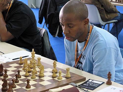 Russel Porter (Jamaica) enroute to an upset win over GM Heikki Westerinen. Copyright © 2006, Daaim Shabazz.