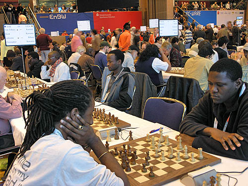 Moses Kawuma (near right) playing against British Virgin Island's Christopher Art. Kawuma scored 9/10 for the highest winning percentage in the open section. Steven Kawuma plays the legendary Bill Hook. Photo by Daaim Shabazz.