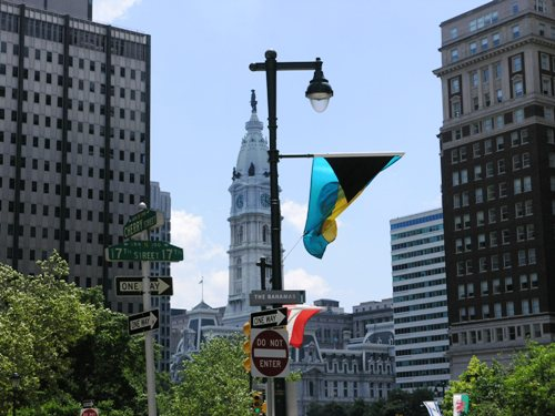 Bahamas flag flying with the City Hall in background. Photo by Daaim Shabazz.