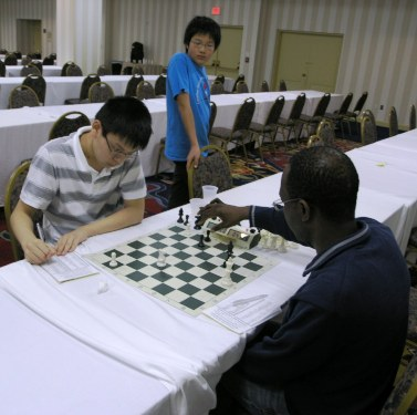 Christopher Heung vs. Kenneth Odeh. Photo by Daaim Shabazz.