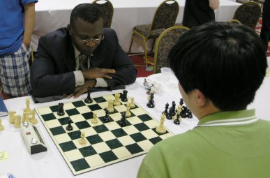 Sylvester Smarty vs. FM Bindi Cheng. Photo by Daaim Shabazz.
