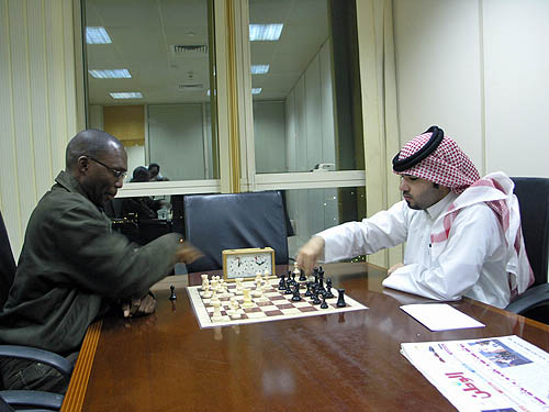 Daaim Shabazz analyzing with FM Ghanim Al-Sulaiti. He is a student at Carnegie-Mellon and has represented Qatar in several events.