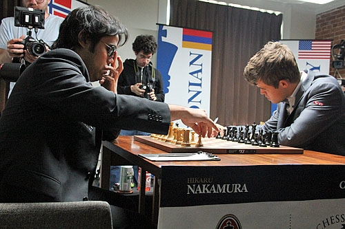Hikaru Nakamura shielding glare from Carlsen's bright star.