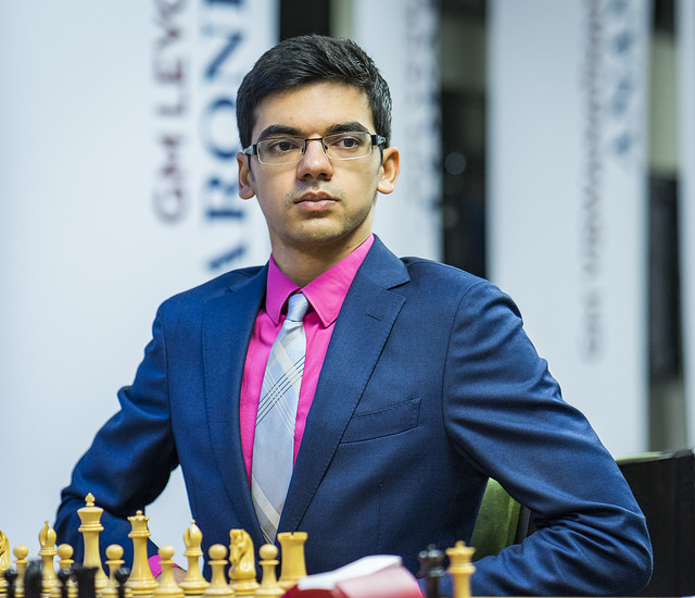 Anish Giri got compliments on his suit, but his play didn't match. Svidler got the win.