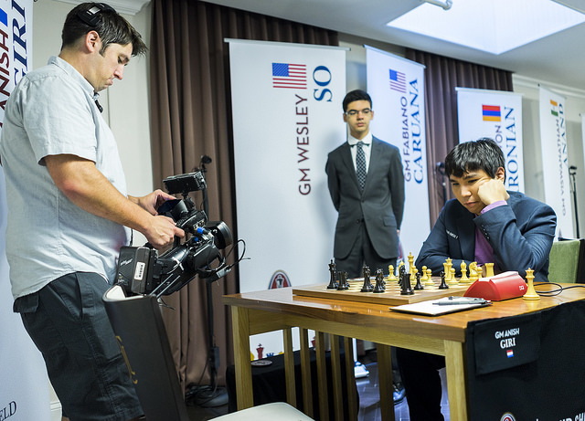 Wesley So on the move as Anish Giri kibitzes.