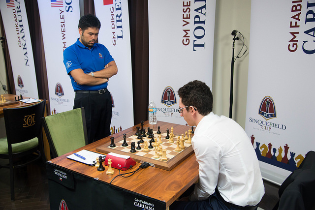 Topalov gives Caruana something to think about while Nakamura looks on.