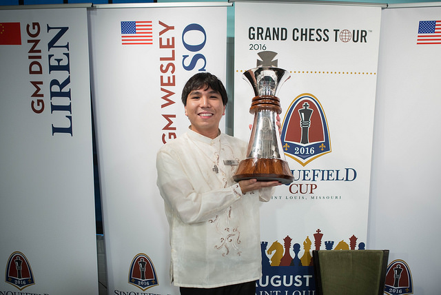 Wesley So, in a beautiful barong, hoists the Sinqufield Cup aloft after winning the 2016 edition.