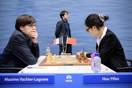 Maxime Vachier-Lagrave versus Hou Yifan, 1-0. Photo by Alina L'Ami.