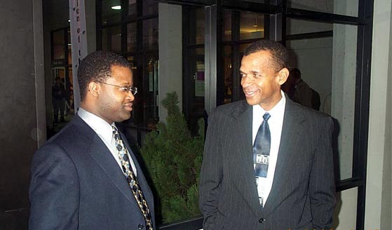 GM Maurice Ashley and FM Stephen Muhammad conversing after having successfully completed the U.S. Chess Championship. Copyright © 2003, Daaim Shabazz.