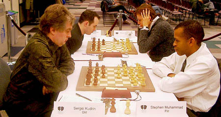 GM Sergey Kudrin vs. FM Stephen Muhammad. Copyright © 2003, Jerry Bibuld.