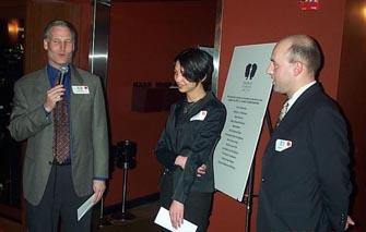 Erik Anderson awarding WIM Anna Hahn and GM Alexander Shabalov their prizes.