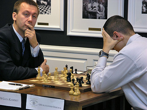 GM Gata Kamsky in a pensive pose while Alexander Onischuk ruminates. Photo by Daaim Shabazz.