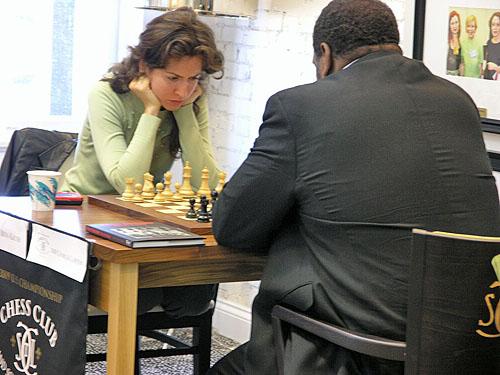 IM Irina Krush vs. Charles Lawton. Photo by Daaim Shabazz.