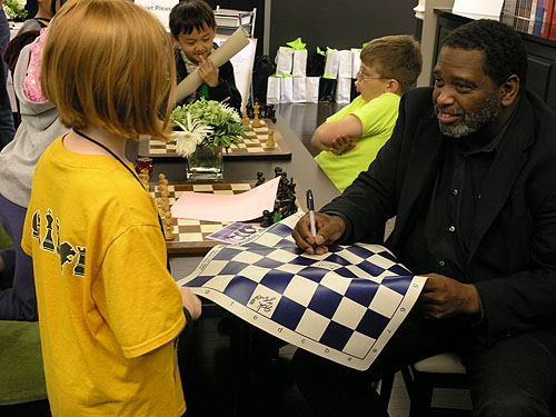 Local legend Charles Lawton interacting with kids. Photo by Daaim Shabazz.