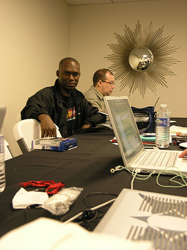 Daaim Shabazz and John Henderson in the press center. Photo by Jared.