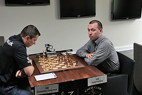 Alexander Onischuk faces off against leader Gata Kamsky, 1/2-1/2.