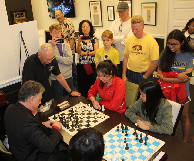 Women's participants playing bughouse with GM Yasser Seirawan.