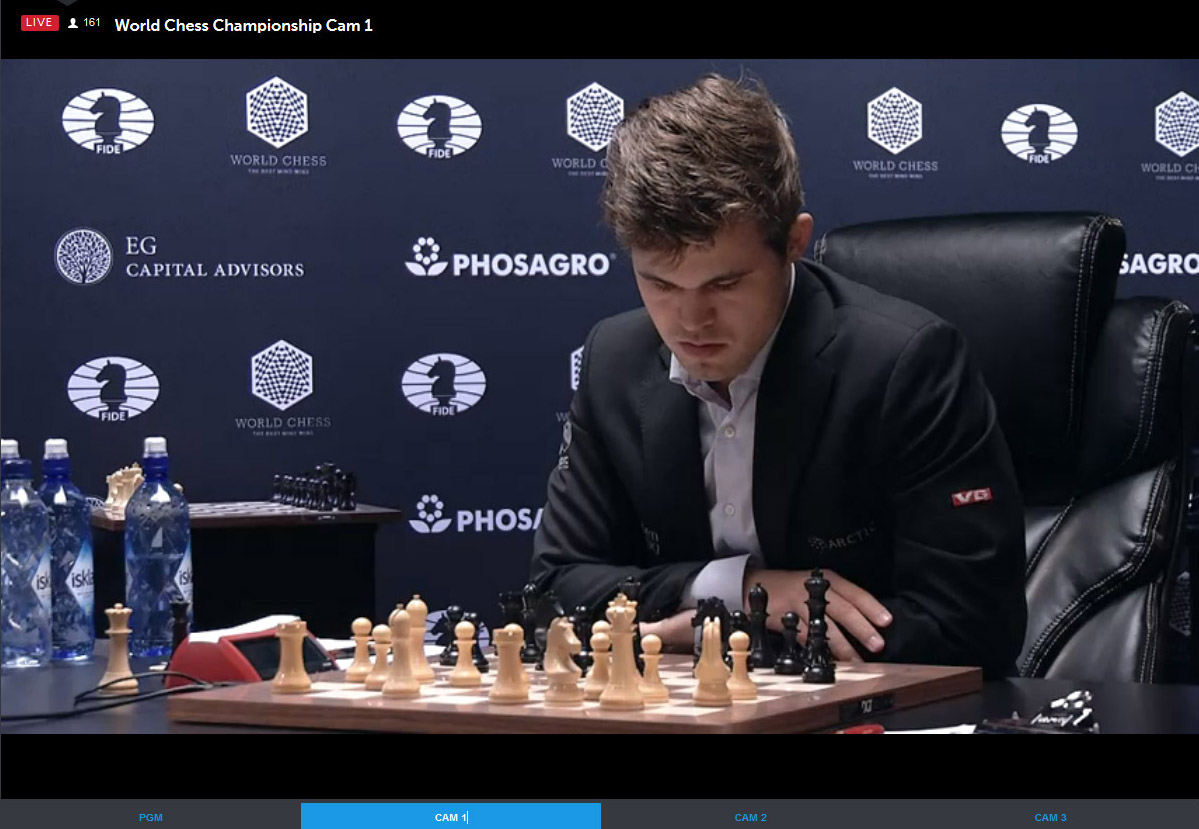 Carlsen ponders move after Karjakin's 15.Qf3