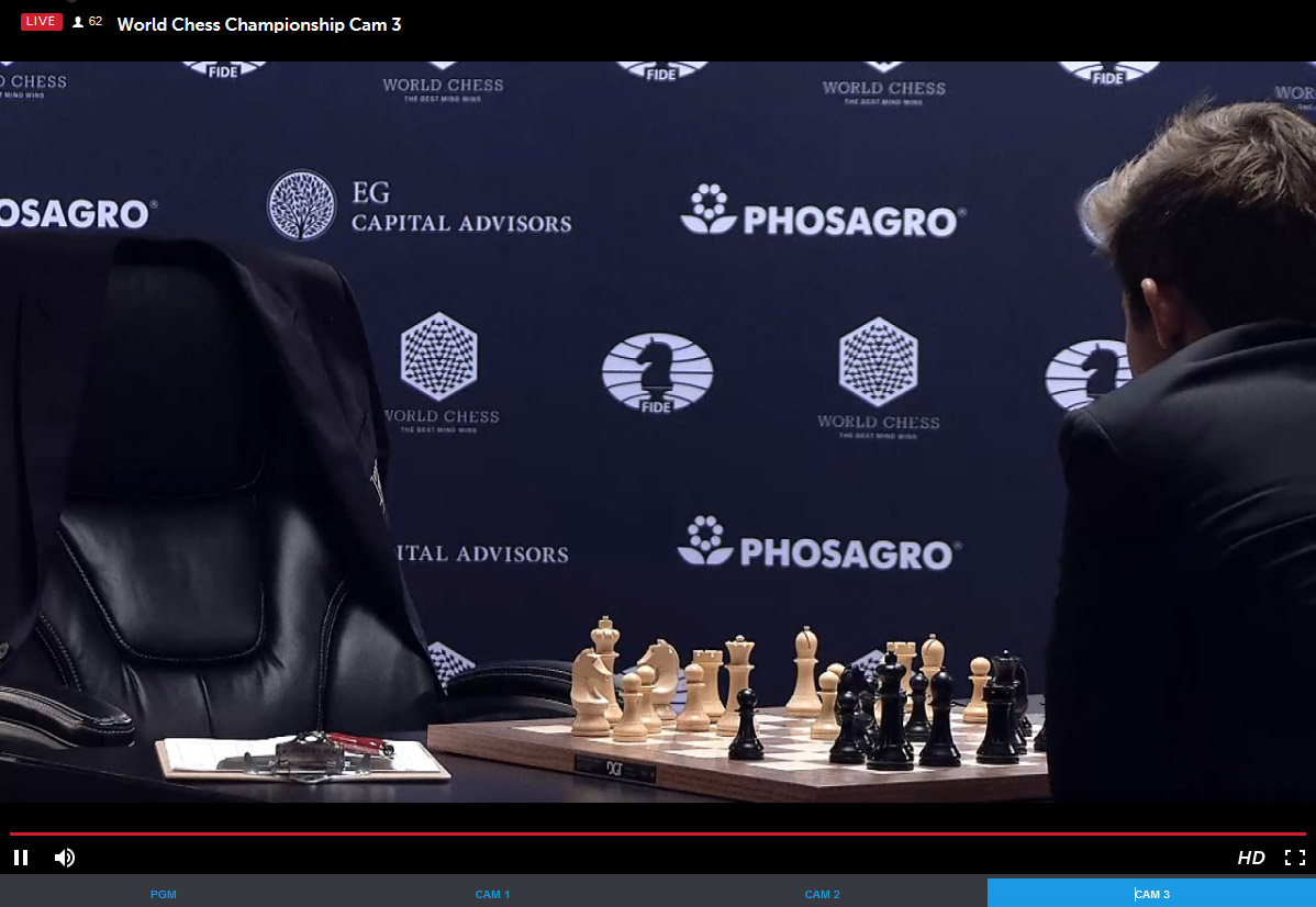 Carlsen ponders move after Karjakin's 15.Qf3