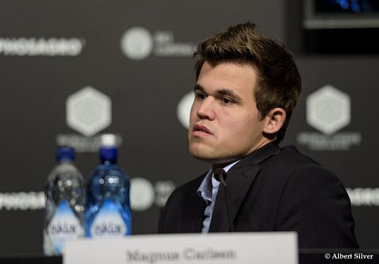 A dejected Carlsen ponders moments before storming out of the press conference. Photo by Albert Silver.