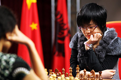 Hou Yifan took advantage of her opponent's shortage of time. Photo by Anastasiya Karlovich for FIDE.
