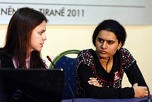 Humpy (right) on the move against Hou Yifan. Photo by Anastasiya Karlovich for FIDE.