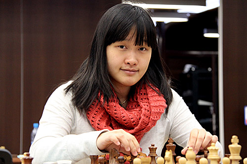 Top seed Zhao Xue still holding her board.