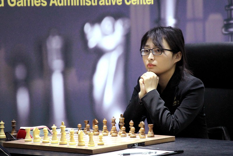 Ju Wenjun had for fight for 85 moves to survive. Photo by Zhang Yanhong