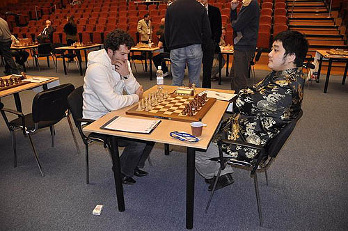 Bacrot of France pondering his strategy against China's Wang Yue.