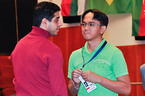 Eshan Ghaem Maghami (Iran) chats with fellow-GM Darwin Laylo (Philippines) before action starts.