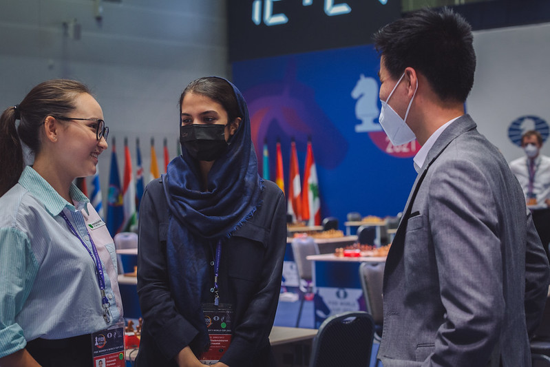 Two very close friends Zhansaya Abdumalik (Kazahkstan) and Sarasadat Khademalsharieh (Iran) chat before the round. Photo by Anastasia Korolkova