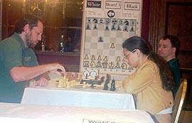 GM Ilya Smirin vs. IM Alexandra Kosteniuk. Copyright © 2003, Daaim Shabazz.