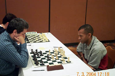 GM Vitali Golod vs. IM-elect Stephen Muhammad, ½-½. Copyright © 2004, Daaim Shabazz.
