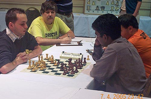 GM Kamil Miton of Poland (left) wins tie-breaking blitz game over IM Magesh Panchanathan of India and was declared the overall champion. Photo by Daaim Shabazz.