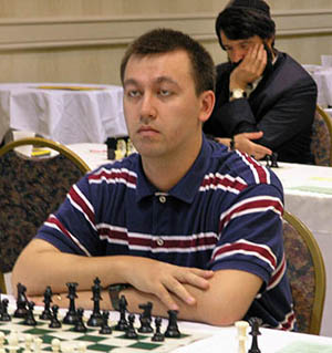 Gata Kamsky was declared the winner of the 2006 World Open after winning a tiebreak blitz match against Vadim Milov. Nine players in total lead the field with 7-2. Leonid Yudasin (background) shared joint 1st. Photo by Daaim Shabazz.