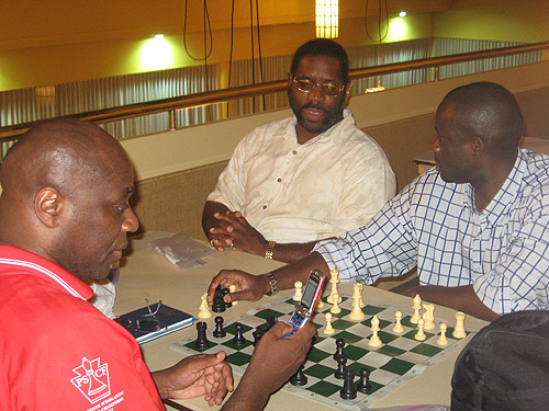 NM Glenn Bady analyzing with IM Oladapo Adu. FM Norman 'Pete' Rogers is always ready for an analysis session.